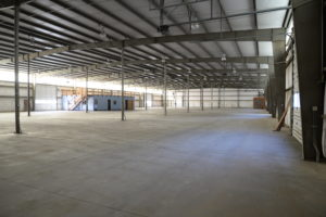 CLEAR SPAN-STORAGE OVER REAT ROOMS AND OFFICE
